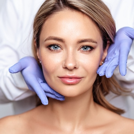 Woman looking at smooth skin in mirror