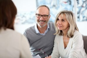 older couple discussing with professional